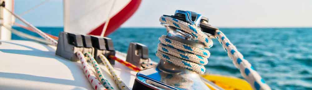 Sail-and-cleet-header